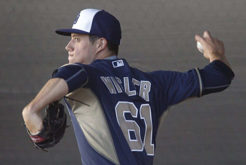 Matt Wisler throws a bullpen session in spring training when he was a member of the Padres organization. The team traded for their former top pitching prospect on Monday.