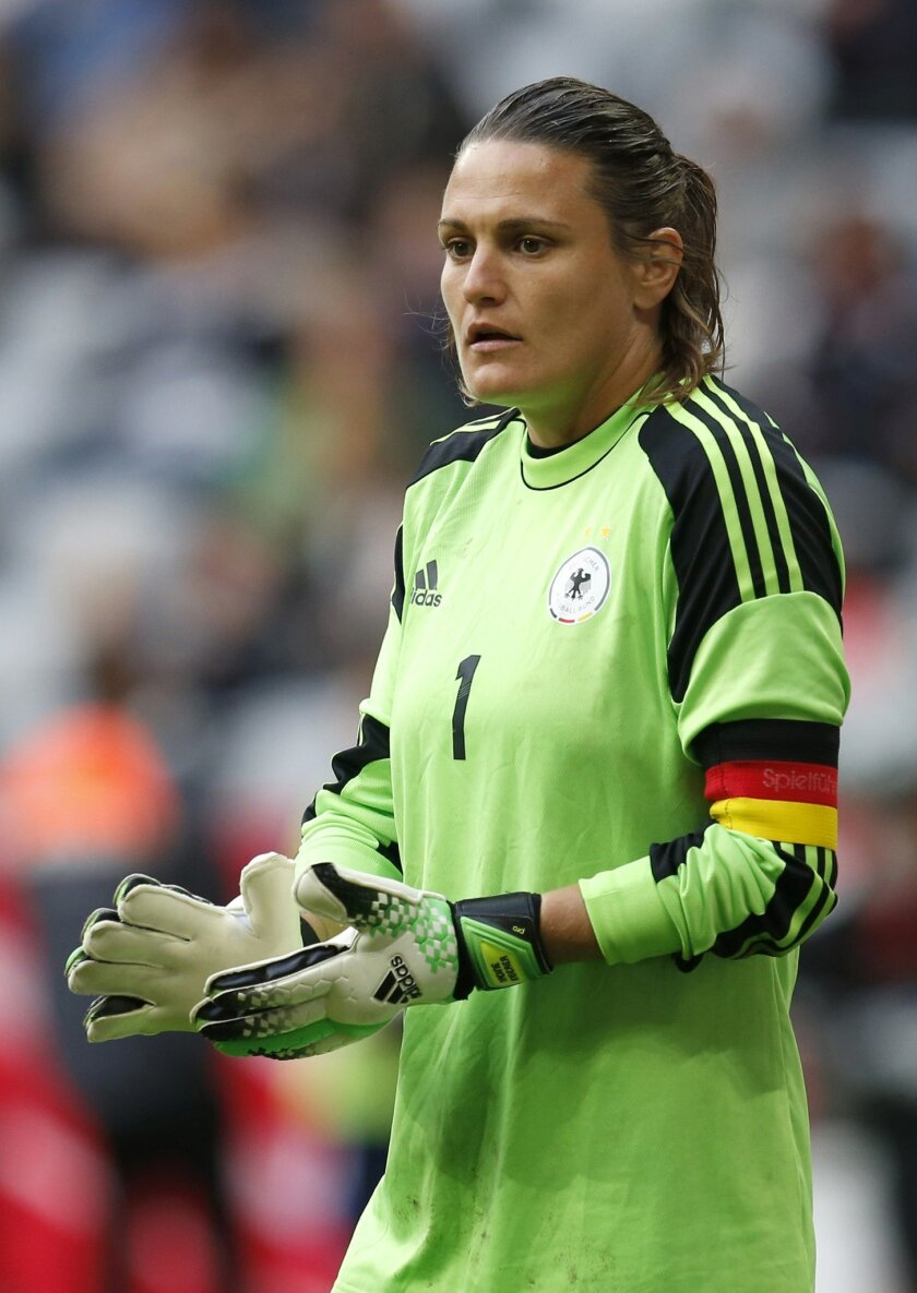 FILE - In this Saturday, June 29, 2013 file photo, Germany goalkeeper Nadine Angerer looks on during the international women's friendly soccer match between Germany and Japan in Munich, Germany. Nadine Angerer long ago started a bucket list of what she wants to do in retirement. The only goalkeeper, male or female to be named FIFA's player of the year will have a sellout crowd wishing her farewell on Sunday, Aug. 31, 2015 when the Portland Thorns host the Washington Spirit. (AP Photo/Matthias Schrader, File)