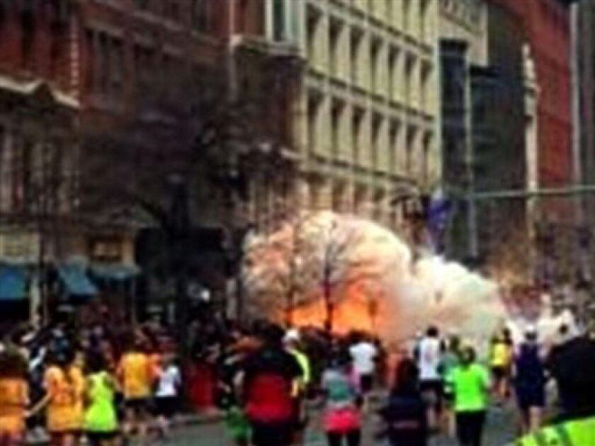 In this image from video provided by WBZ TV, spectators and runners run from what was described as twin explosions that shook the finish line of the Boston Marathon, Monday, April 15, 2013, in Boston.  Two explosions shattered the euphoria of the Boston Marathon finish line on Monday, sending autho
