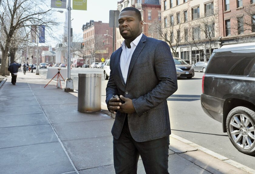 """FILE - In this Wednesday, March 9, 2016 file photo, Curtis """"50 Cent"""" Jackson arrives at court for a federal bankruptcy hearing in Hartford, Conn. On Wednesday, July 6, 2016, a federal bankruptcy court judge in Connecticut approved a plan for Jackson to reorganize his finances and pay back creditors"""