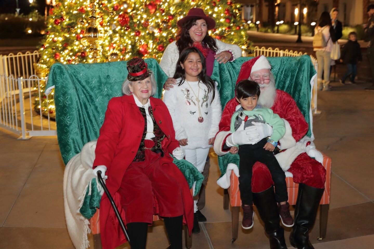 The Penaloza family visits Santa and Mrs. Claus at the Village at Pacific Highlands Ranch