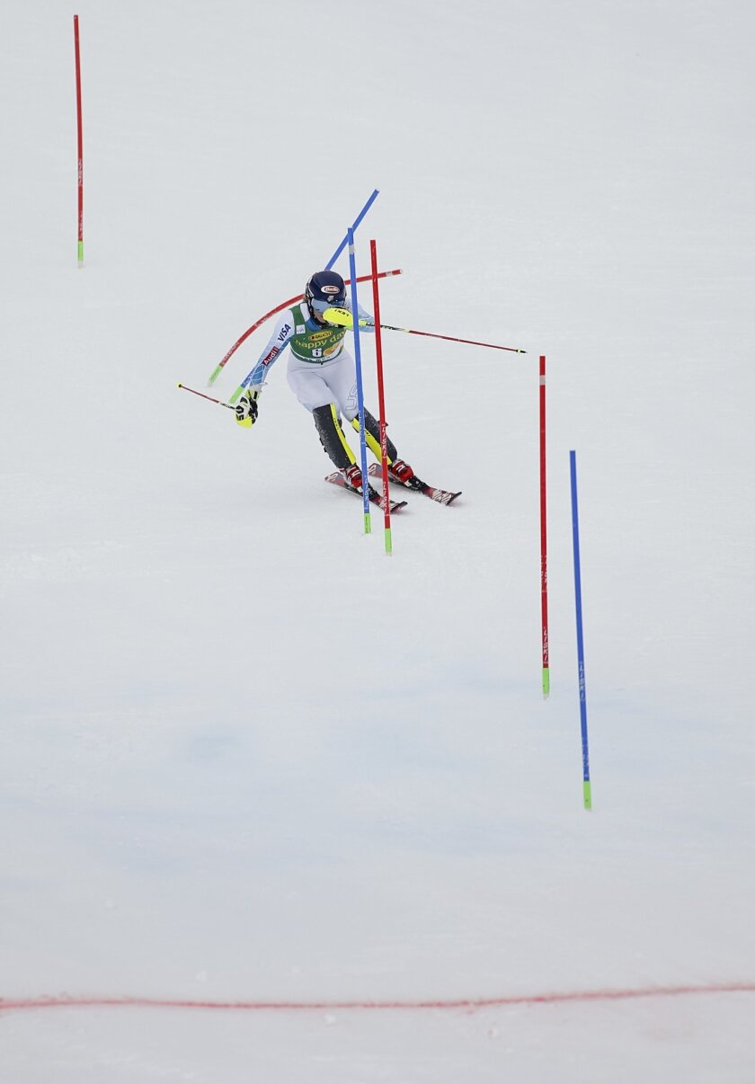 Mikaela Shiffrin, of the United States, speeds down the course on her way to win an alpine ski, women's World Cup slalom, in Crans Montana, Switzerland, Monday, Feb. 15, 2016. (AP Photo/Gabriele Facciotti)