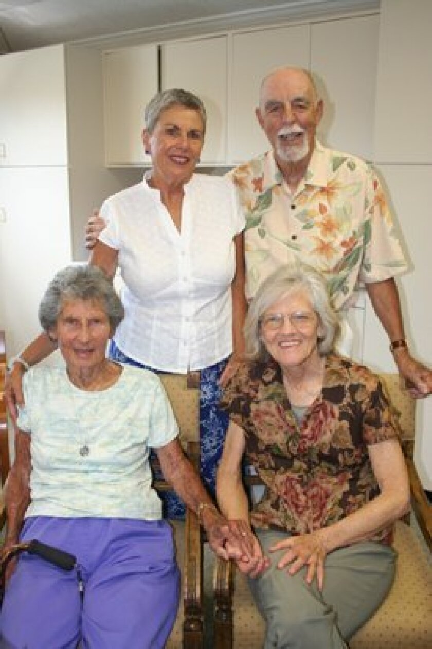 (Right) Longtime Rancho Santa Fe Library employee Ginny Dewey, front row left, enjoyed a retirement party on Sept. 4 with Jo Moeller (front row, right), and (back row) Ginger Bord and Harry Bord.  Photo/Karen Billing