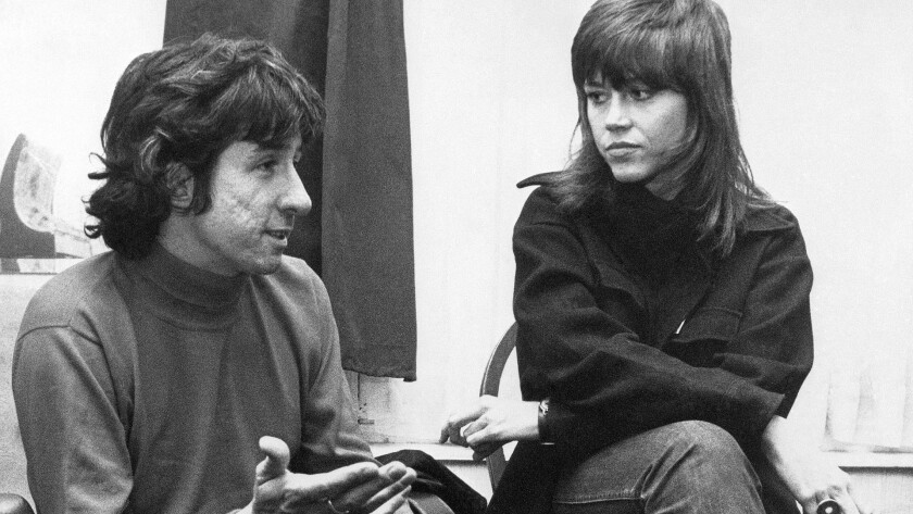 Dec. 26, 1972: Actress Jane Fonda, right, and Tom Hayden, one of the founders of SDS, talk at the home of a friend in London, after their arrival from Paris.