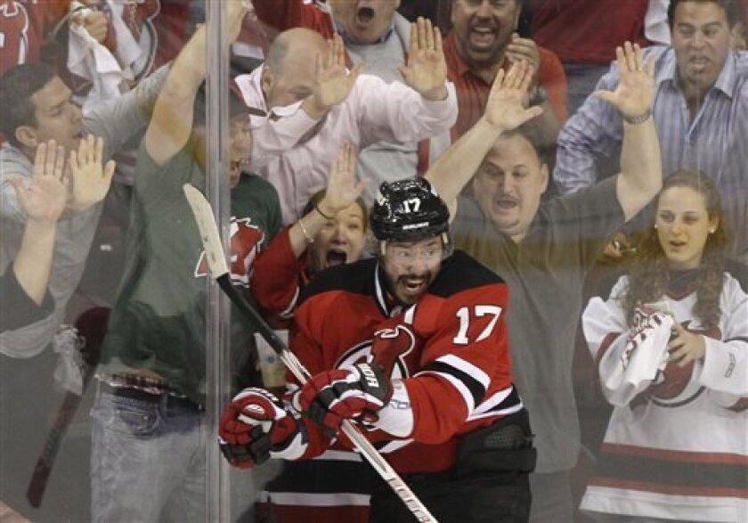 FILE - In this May 25, 2012, file photo, New Jersey Devils' Ilya Kovalchuk, of Russia, celebrates in front of fans after scoring a goal during Game 6 of the NHL hockey Stanley Cup Eastern Conference finals against the New York Rangers, in Newark, N.J. Kovalchuk is retiring from the NHL and returning to Russia. The Devils announced the stunning news Thursday afternoon, July 11, 2013, in a statement, saying that the 30-year-old Kovalchuk had alerted general manager and president Lou Lamoriello ear