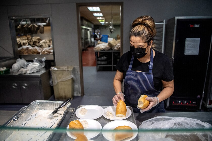 Margarita Motero prepares meals at Union Rescue Mission, which is still serving hot meals  during the COVID-19 pandemic.