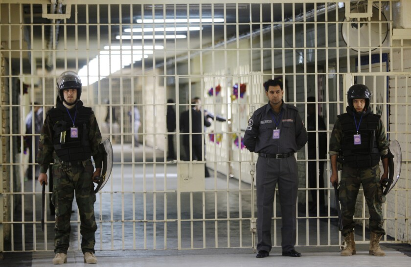 Al Qaeda-allied Islamic State of Iraq and the Levant claimed responsibility for storming Abu Ghraib prison and freeing hundreds of fighters.