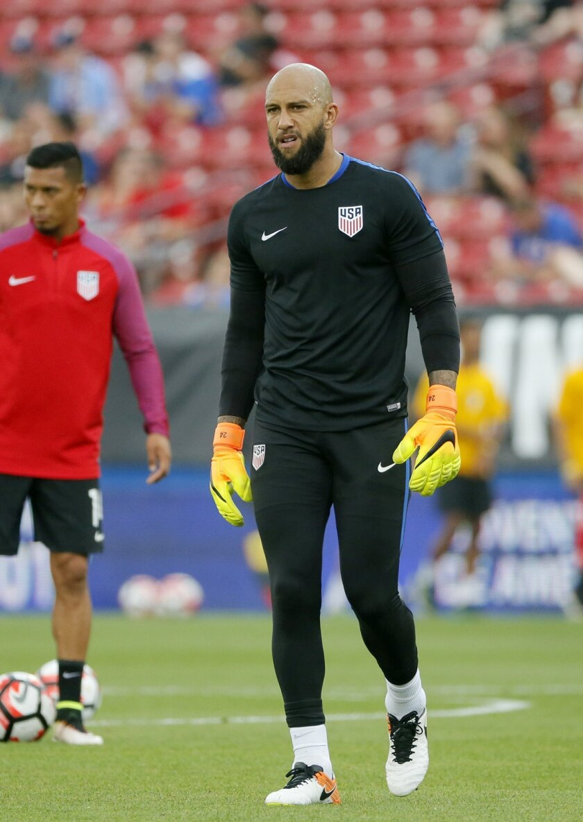 U.S. goalie Tim Howard walks across the field as players warm up for an exhibition soccer match against Ecuador, Wednesday, May 25, 2016, in Frisco, Texas. (AP Photo/Tony Gutierrez)