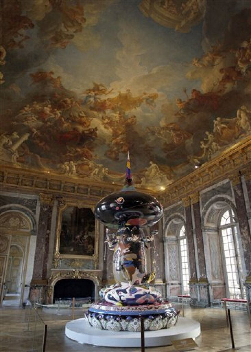 """A sculpture by Japanese artist Takashi Murakami entitled """"Tongari-Kun"""" is displayed at the Versailles Palace, west of Paris, Thursday, Sept. 9, 2010. Murakami's exhibition will run from Sept. 14 until Dec. 12, 2010. (AP Photo/Christophe Ena)"""