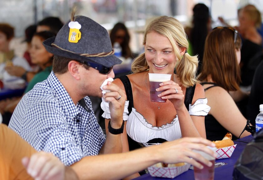 Emma Brown and her husband, Cory Brown, of Del Mar are attired in her traditional dirndl and his Tyrol hat at La Mesa's Oktoberfest. John Gastaldo • U-t photos