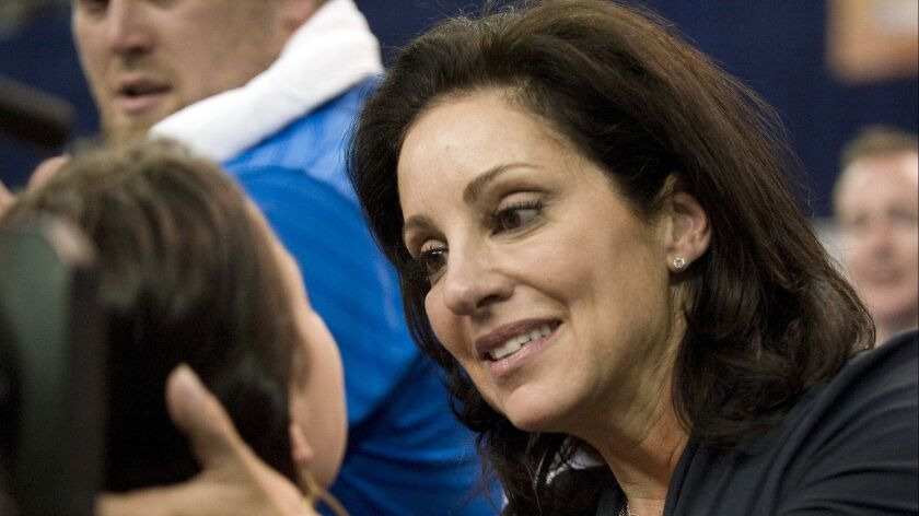 FILE - In this April 23, 2010, file photo, UCLA gymnastics coach Valorie Kondos Field, right, congra