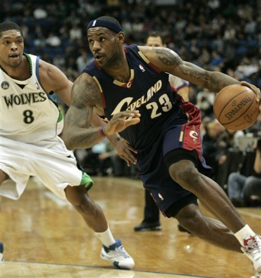 Cleveland Cavaliers forward LeBron James (23) drives against Minnesota forward Ryan Gomes (8) during the first half in an NBA basketball game, Wednesday, Dec. 17, 2008, in Minneapolis. (AP Photo/Paul Battaglia)