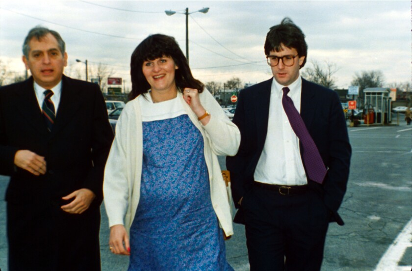 Surrogate mother Mary Beth Whitehead-Gould, center, and her husband, Dean Gould, arrive for the start of a hearing on her visitation rights with her 2-year-old daughter, known as Baby M, in Hackensack, N.J., Monday, March 29, 1988. Man at left is unidentified.