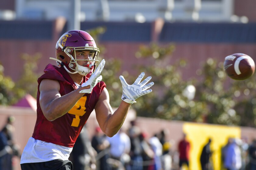 USC wide receiver Bru McCoy is set to make his debut for the Trojans next month, and his family is hoping to be in attendance