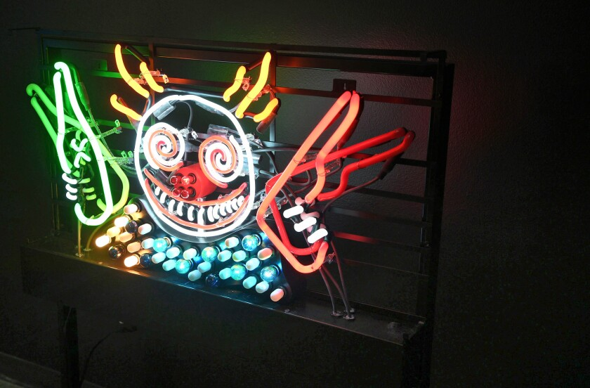 """Guns 'n Booze"" is one of the pieces featured in the Neon Museum show of Tim Burton's work."