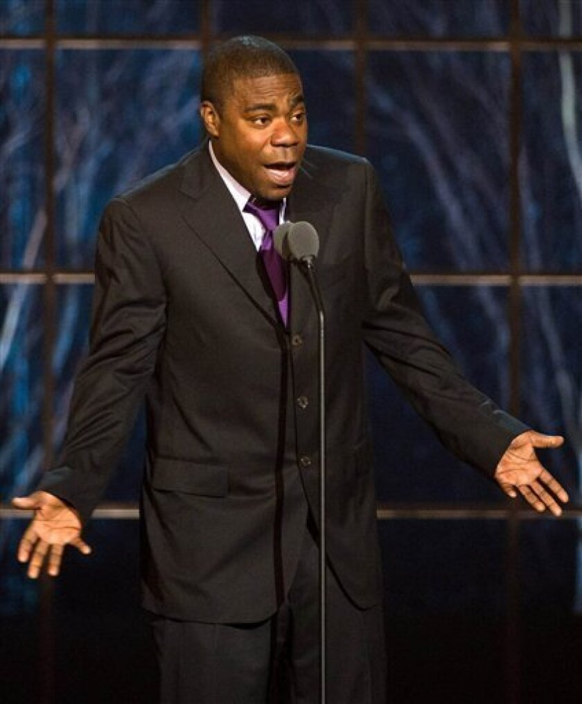 """FILE - In this March 26, 2011 file photo, actor and comedian Tracy Morgan appears onstage at the """"The Comedy Awards"""" presented by Comedy Central in New York. Morgan says he's sorry for telling an audience that he would """"pull out a knife and stab"""" his son for being gay. The comedian and """"30 Rock"""" actor apologized Friday, June 10, 2011, to his fans and the gay and lesbian community for what he called """"my choice of words"""" during his June 3 appearance at Nashville's Ryman Auditorium. (AP Photo/Charles Sykes, file)"""