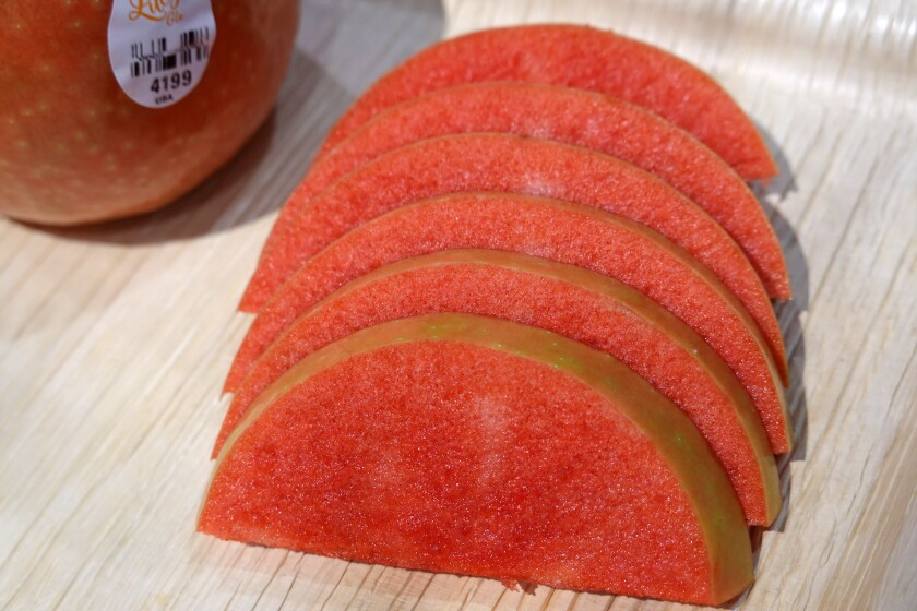 Slices of red-fleshed Lucy Glo brand apple