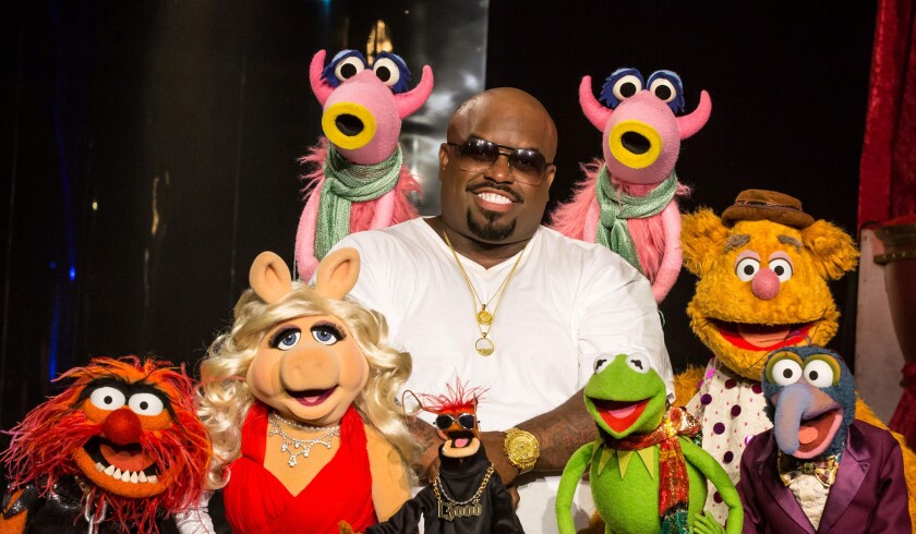 """Recording artist Cee Lo Green hangs out with the Muppets for a 2012 holiday special, """"Cee Lo's Magic Moment,"""" which ran on the TV Guide Network."""