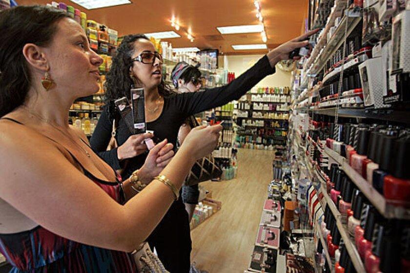 COLOR COORDINATORS: Beckielou Brown, left, and Nadia El Kholti Pettigreen pick out nail polish at Larchmont Beauty Center.