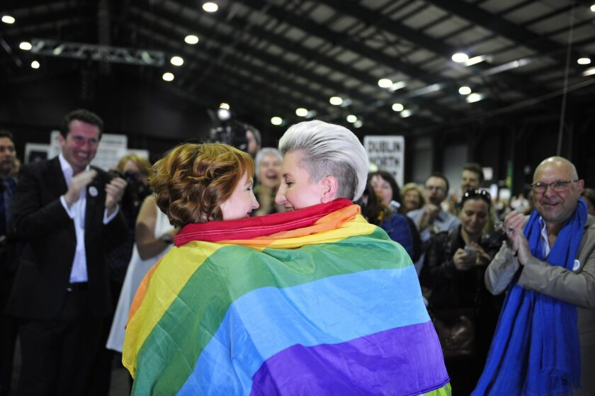 Monnine Griffith, left, and Clodagh Robinson celebrate after early results suggested an overwhelming majority in favor of the Irish referendum on same-sex marriage.