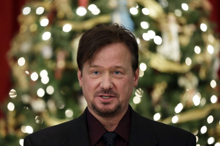 The Rev. Frank Schaefer, a United Methodist clergyman convicted of breaking church law for officiating at his son's same-sex wedding, has been defrocked by the church. Above, Schaefer at a news conference Monday.