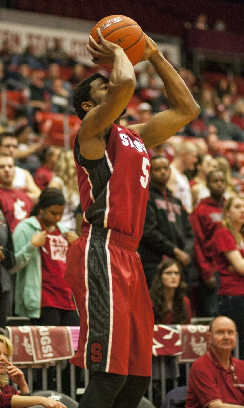 Stanford guard Chasson Randle (5) scores a 3-point basket from in front of the Washington State student section during the first half of an NCAA college basketball game on Saturday, Feb. 15, 2014, at Beasley Coliseum in Pullman, Wash. (AP Photo/Dean Hare)