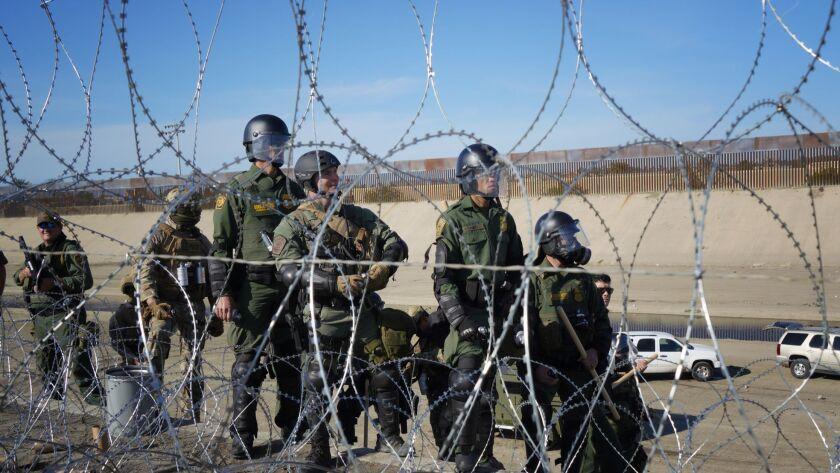 U.S. Border Patrol observes migrants on the U.S. Mexico border near San Ysidro.