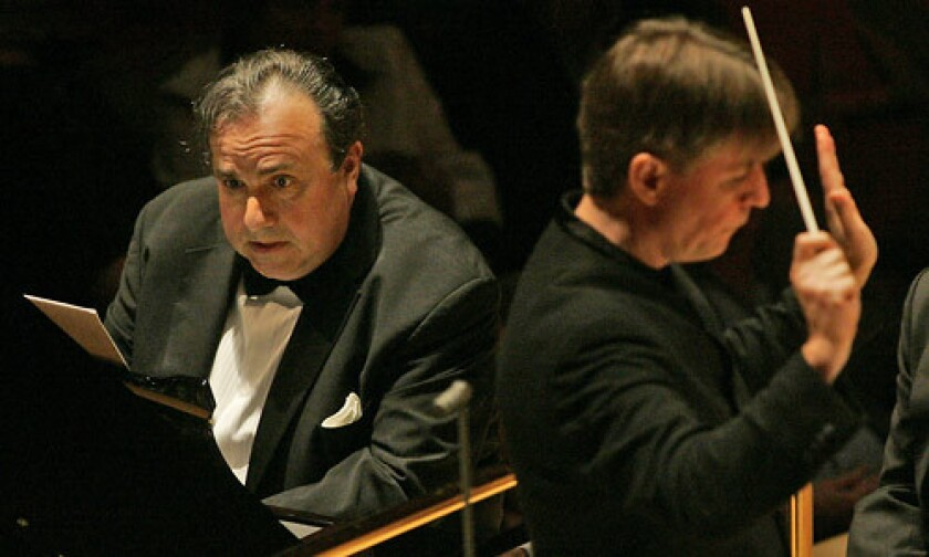 Yefim Bronfman, left, plays piano as Esa-Pekka Salonen conducts the LA Philharmonic performing a piano concerto by Salonen at the Walt Disney Concert Hall.