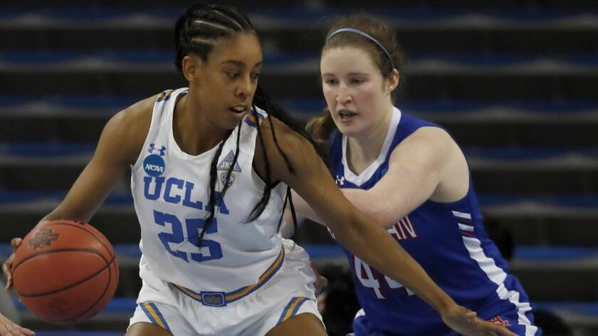 UCLA forward Monique Billings scores 20 points against Cecily Carl and American on Saturday at Pauley Pavilion.
