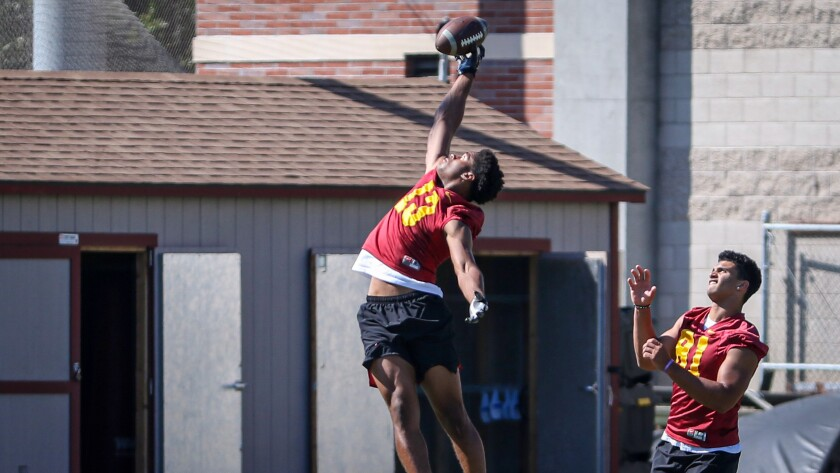 USC freshman Munir McClain leaps up for a pass on the sideline Monday.