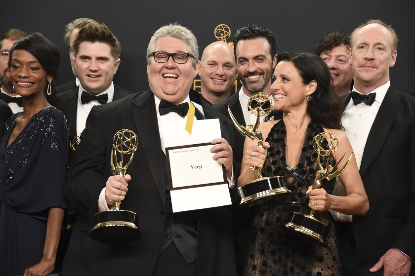 """David Mandel, center, Julia Louis-Dreyfus, foreground right, and the cast and crew from """"Veep"""" winners of the award for comedy series  at the 68th Primetime Emmy Awards."""