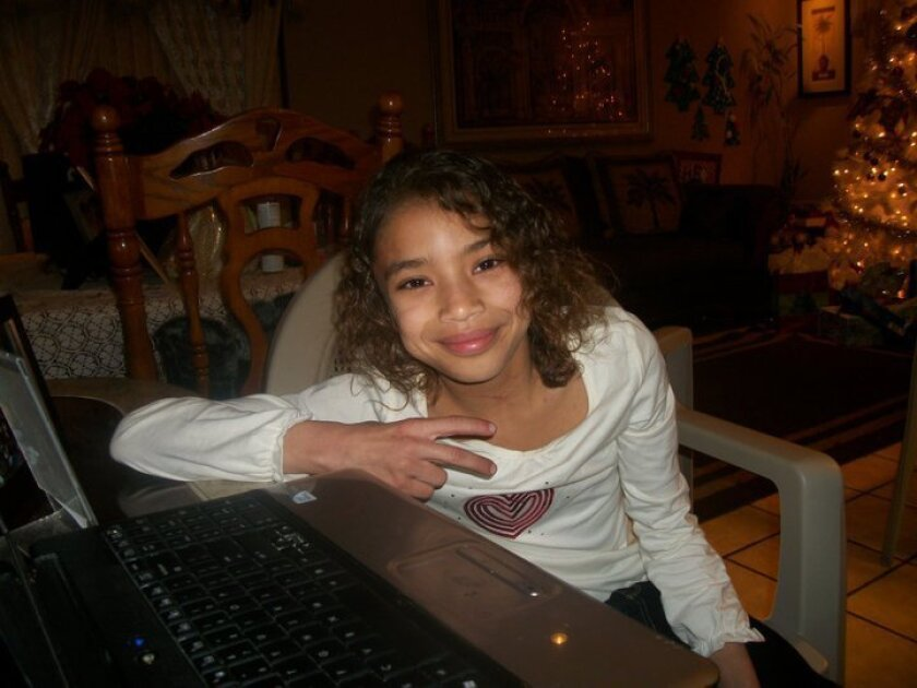 Elizabeth Holloway is shown on Christmas Eve 2010 at a family party. The 9-year-old died Jan. 17, 2011, after a blow to her body by her mother, Crystal Cardenas.