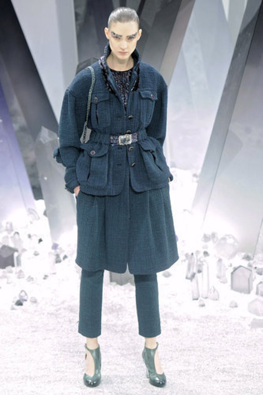 A model walks the runway at Chanel's fall 2012 fashion show in Paris.