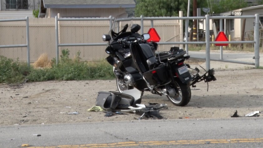 An Oceanside Police Department motorcycle was badly damaged in a crash Wednesday evening on state Route 76 in Pala, but the officer riding it home suffered only a wrist injury.