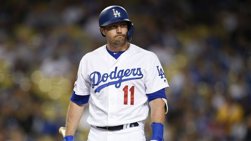 Los Angeles Dodgers' A.J. Pollock reacts after a strike during the first inning of an MLB baseball g