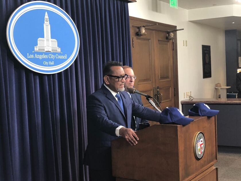 L.A. City Councilmen Gil Cedillo, left, and Paul Koretz speak to reporters before Tuesday's vote calling on Major League Baseball to award the Dodgers the 2017 and 2018 World Series championships.