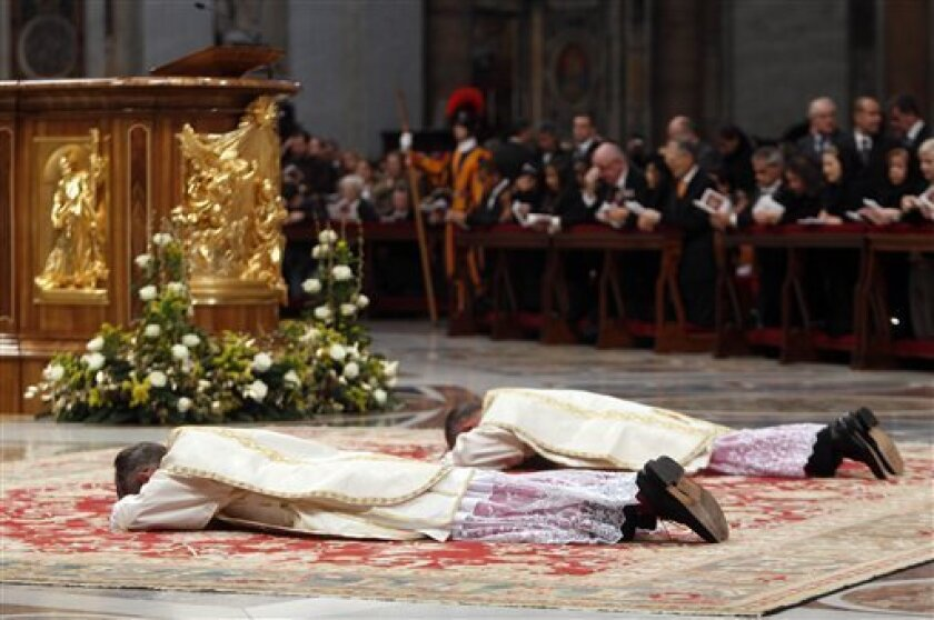 Newly elected US bishop Charles John Brown, left, and newly elected bishop Marek Solczynski from Poland lay during their ordaining ceremony led by Pope Benedict XVI in St. Peter' s Basilica at the Vatican, Friday, Jan. 6, 2012. (AP Photo/Pier Paolo Cito)