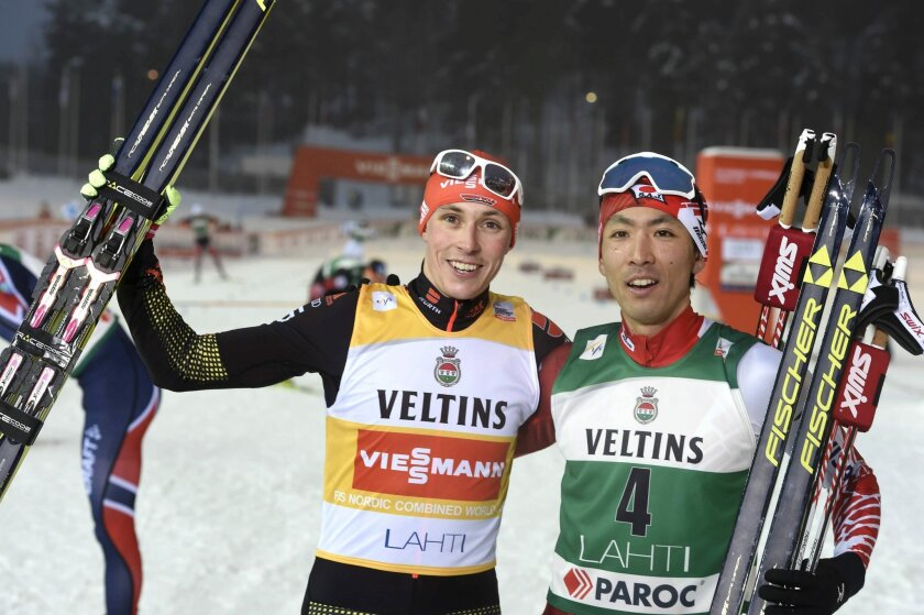 Winner Eric Frenzel of Germany, left,  and second placed Akito Watabe of Japan at the finish of the Cross-Country Individual Gundersen (10 km) of the Nordic Combined FIS World Cup competition at the Lahti Ski Games, the Pre-World Championships, in Lahti, Finland, on Friday Feb. 19, 2016.  (Jussi Nu