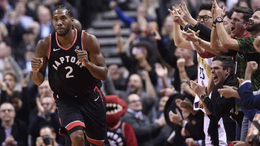 Fans cheers after Toronto Raptors forward Kawhi Leonard (2) makes a basket against the Denver Nugget