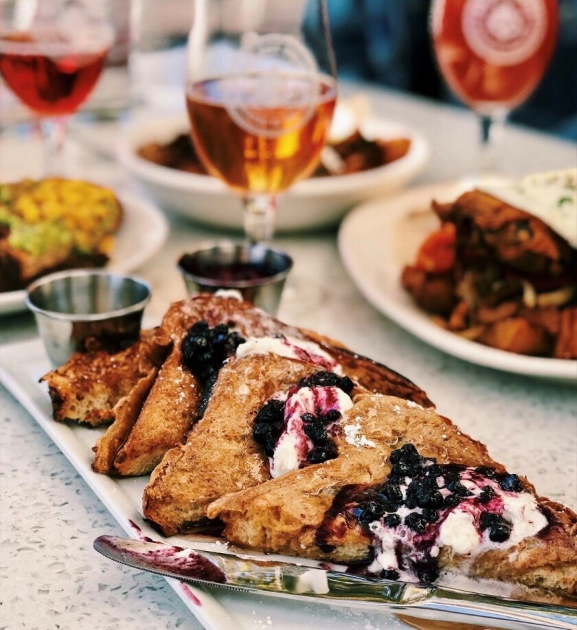 Ballast Point's Mother's Day brunch carry out, which includes brioche french toast and a crowler of beer.