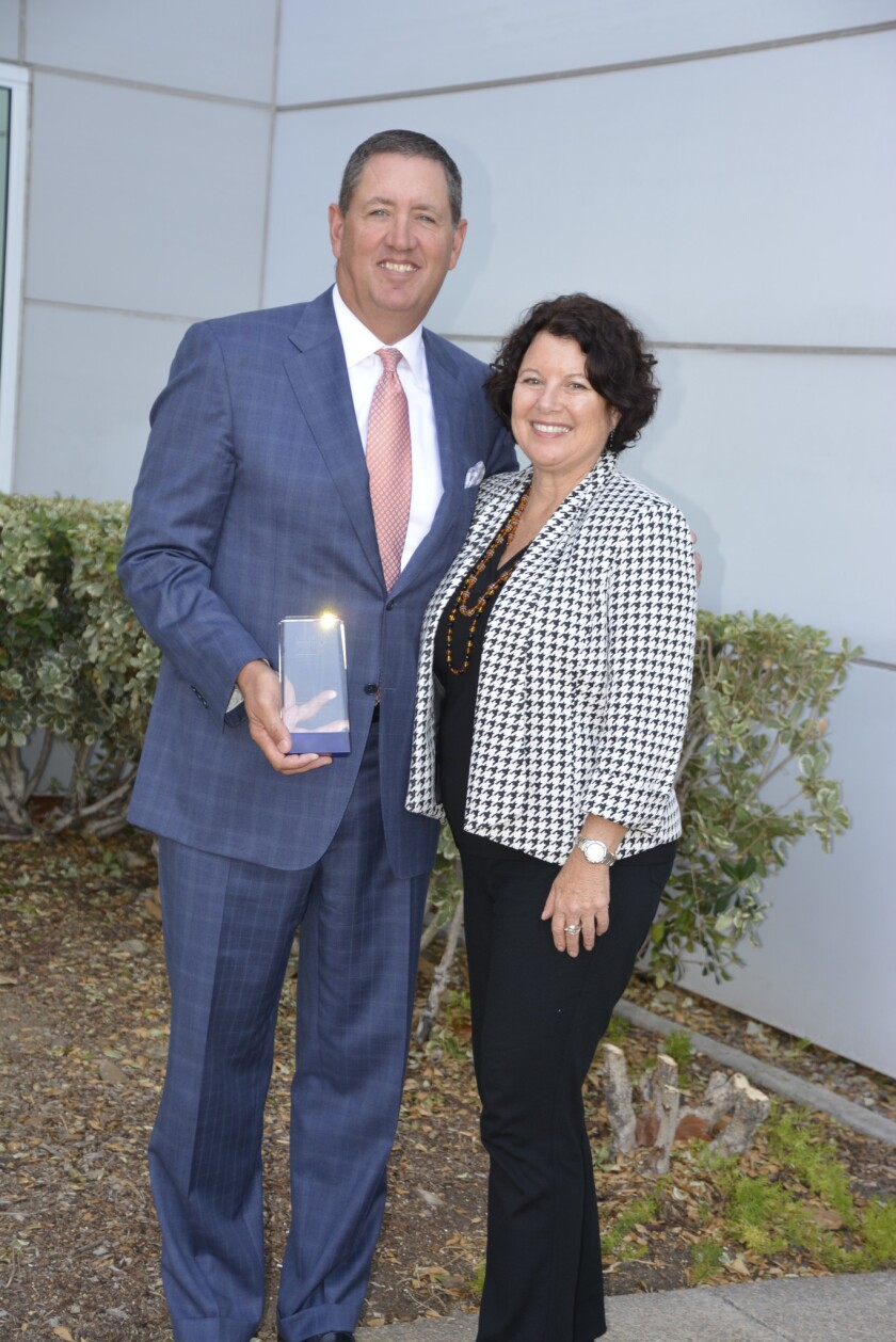 """Rancho Santa Fe resident Kenneth """"Ken"""" Weixel with United Way President and CEO Laurie Coskey, Ed.D."""