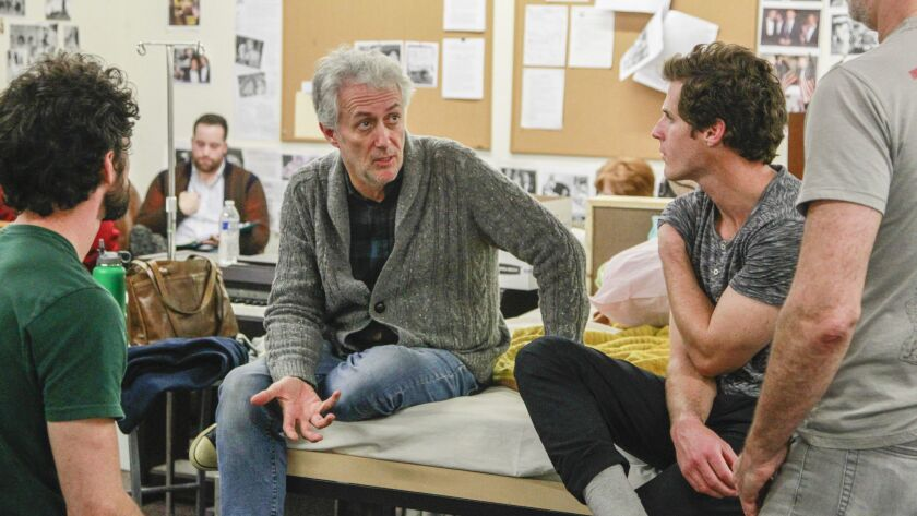 """Angels in America"" director and Cygnet Theatre artistic chief Sean Murray talks over a scene with cast and crew."