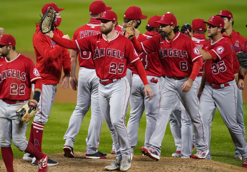 Angels first baseman Jared Walsh celebrates with teammates after a win over the Colorado Rockies.