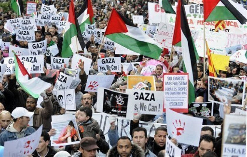 Protesters shout slogans against the Israeli military offensive in Gaza during a demonstration in Barcelona, Spain, Saturday, Jan. 10, 2009. Similar protests have occurred almost daily in the Middle East and elsewhere since Israel launched its operation more than two weeks ago to stop rocket fire f