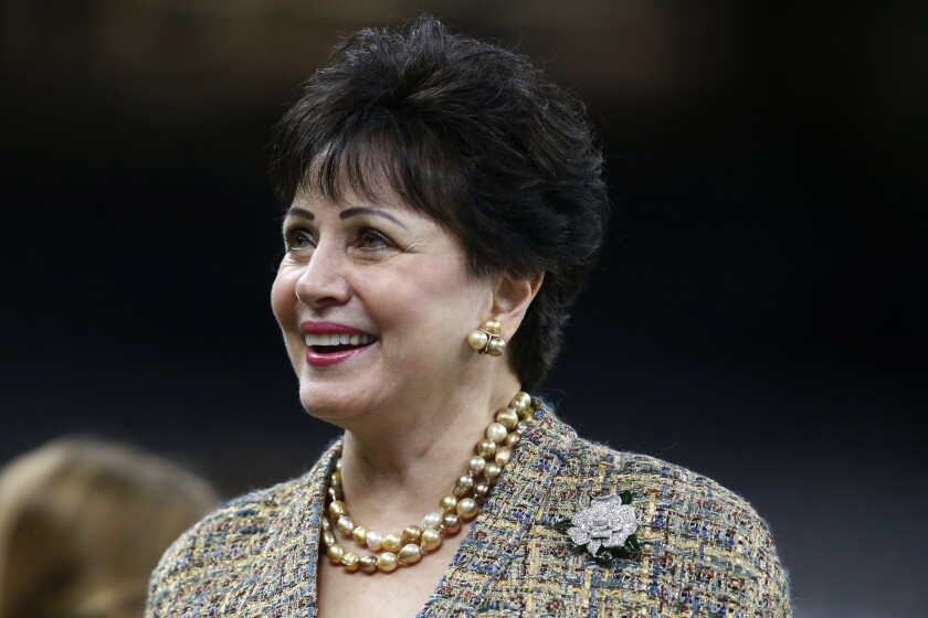 """FILE - In this Nov. 24, 2019, file photo, New Orleans Saints owner Gayle Benson, watches the team warm up, before an NFL football game against the Carolina Panthers in New Orleans. The Saints contend their behind-the-scenes public relations work on the area's Roman Catholic sexual abuse crisis was """"minimal,"""" but attorneys suing the church allege hundreds of confidential Saints emails show just the opposite, the team actively helping to shape a list of credibly accused clergy that appears to be an undercount. Benson, who is close friends with the local archbishop, have disputed as """"outrageous"""" any suggestion that the team helped cover up crimes. (AP Photo/Butch Dill, File)"""