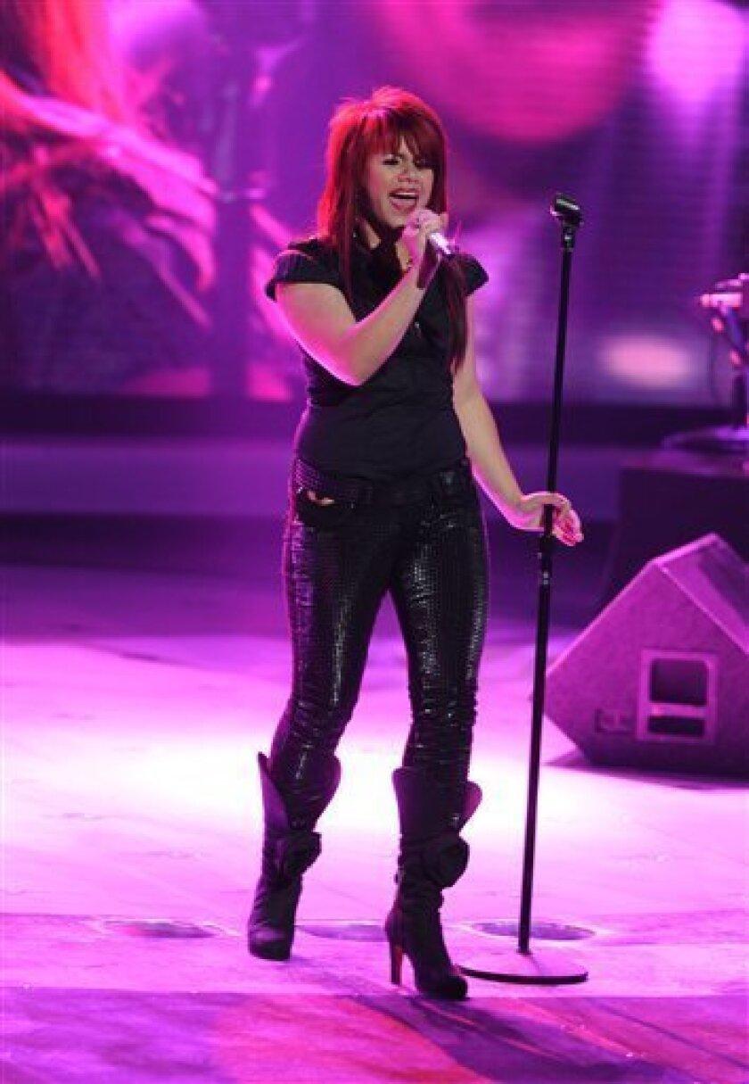 This May 5, 2009 photo provided by FOX shows Allison Iraheta performing on American Idol in Los Angeles. (AP Photo/FOX, Ray Mickshaw)