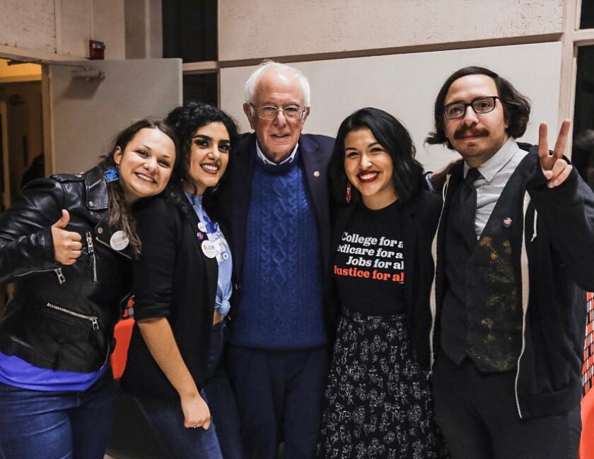 Jewel Hurtado, 21, second from right, with Sen. Bernie Sanders.