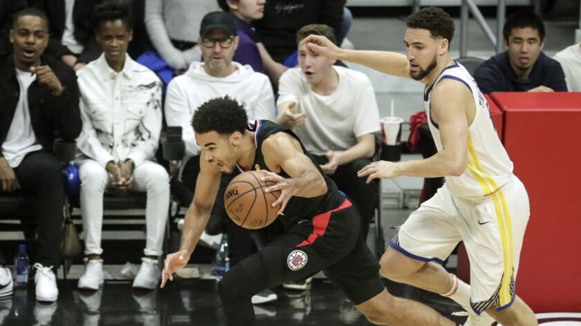 LOS ANGELES, CA, SUNDAY, APRIL 21, 2019 - Clippers guard Jerome Robinson steals the ball from Warrio