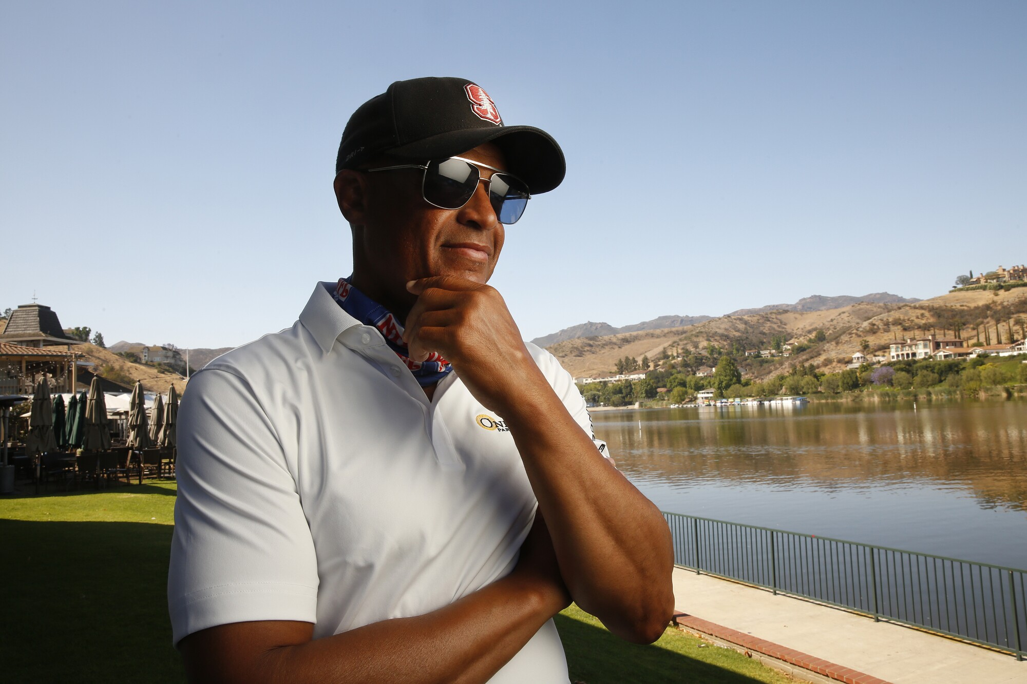 Former NFL football player Toi Cook pauses by a waterfront in Westlake Village.