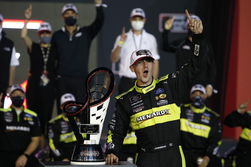Austin Cindric celebrates in Victory Lane with the season championship trophy after winning.
